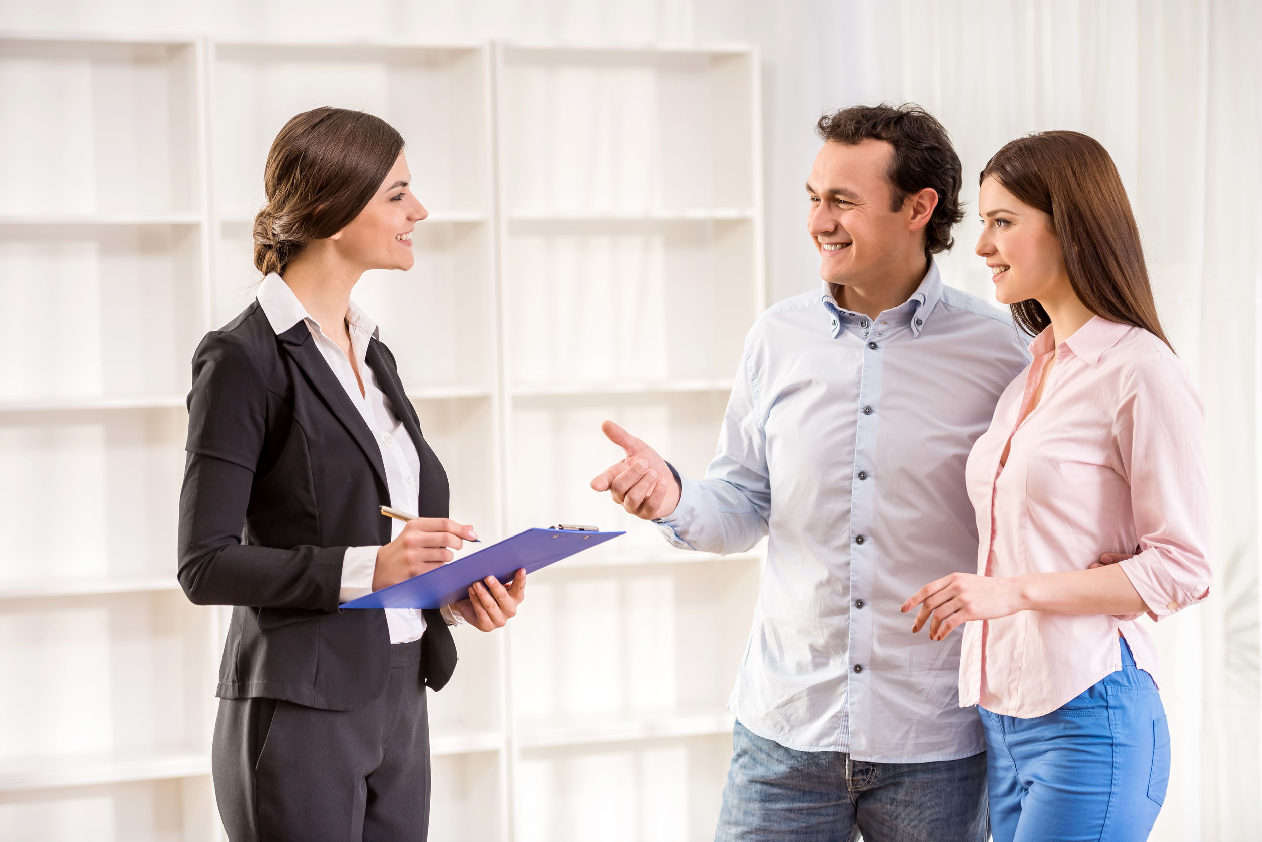 Young couple meeting with real estate agent